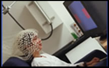 Student completing a cognitive task while wearing an EEG cap